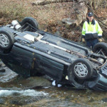 Car flipped in Darby Creek under 476 in Broomall