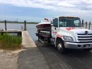 Trailer Towing truck with boat